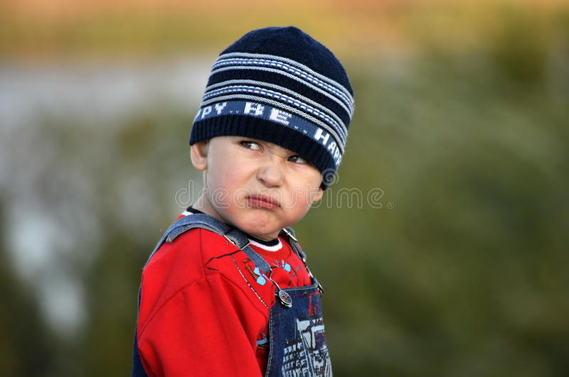 Funny portrait of a boy. With a bad mood royalty free stock image