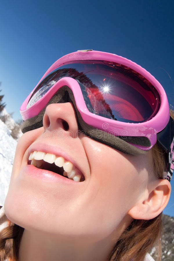 Funny portrait of girl skier. Funny close portrait of a young girl in ski mask. Winter vacation royalty free stock photography