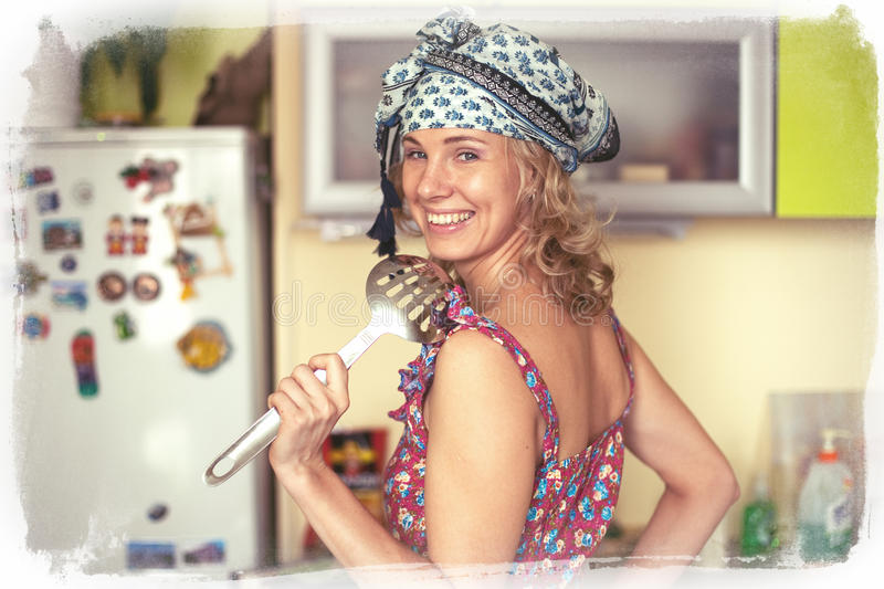 Funny portrait of the housewife in the kitchen royalty free stock photo