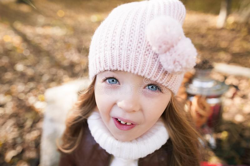Funny portrait of a little girl. The girl in the pink hat stares in surprise at the camera. Close-up royalty free stock images