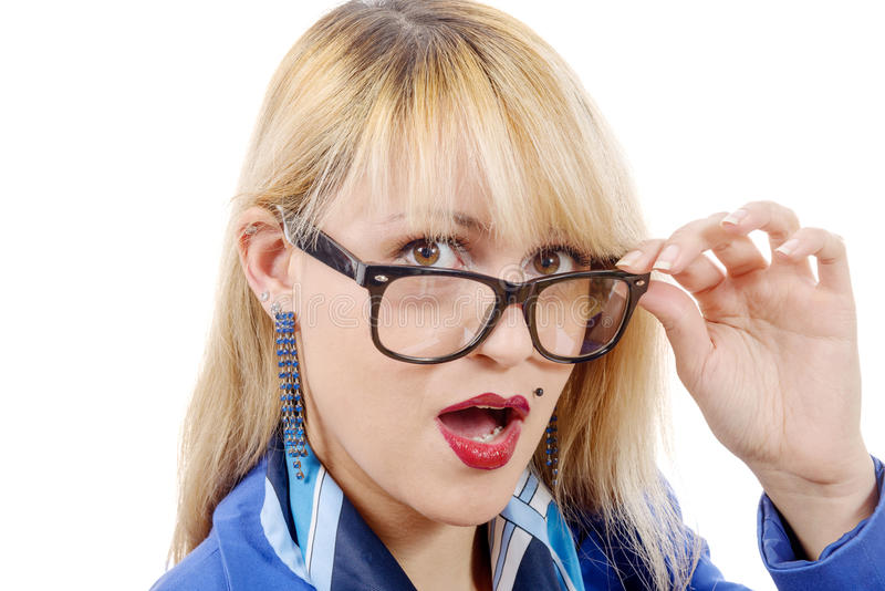 Funny portrait of a pretty blonde woman. A funny portrait of a pretty blonde woman with glasses , on white royalty free stock image
