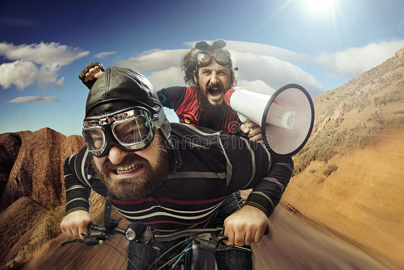 Funny portrait of a tandem of cyclists stock image