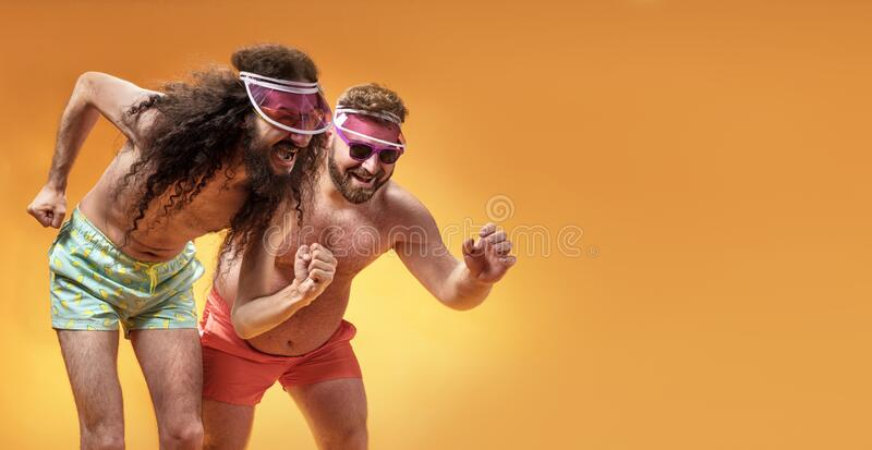 Funny portrait of two antagonist friends on vacation royalty free stock image