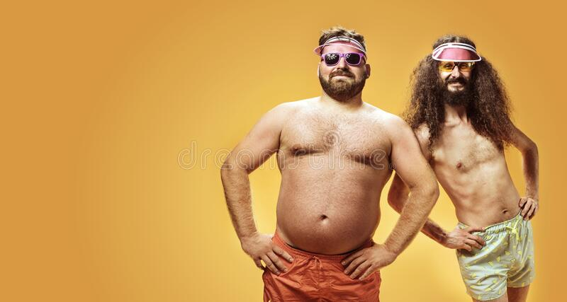 Funny portrait of two antagonist friends on vacation stock photography