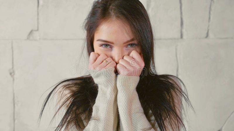 Funny portrait of young woman in sweater, playfully flirts stock image