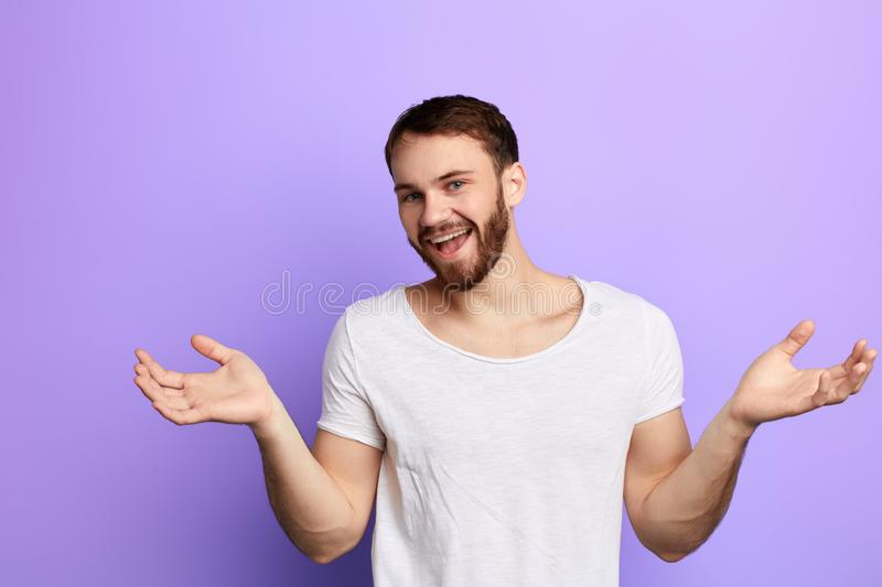 Funny positive happy man greeting people with raised arms stock photo