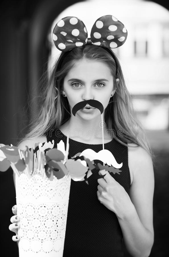 Funny pretty girl with cute mouse ears and black moustache royalty free stock image
