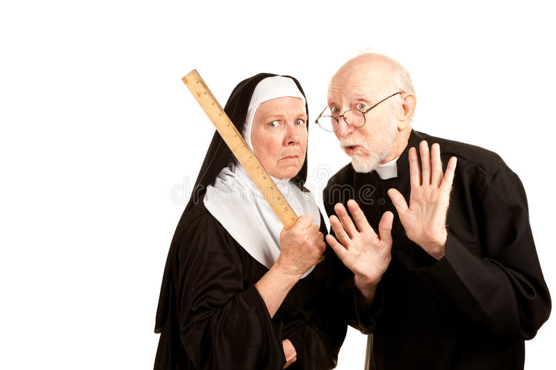 Funny Priest and Nun. Funny priest admonishes mean nun not to use ruler as a weapon stock images