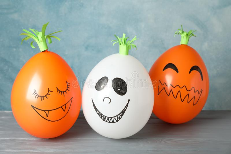 Funny pumpkins on grey wooden background royalty free stock photography