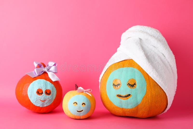 Funny pumpkins on pink background stock images
