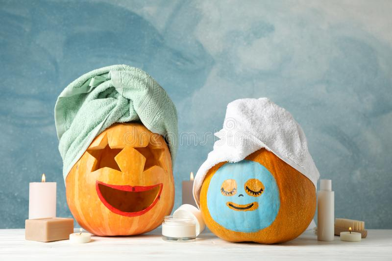 Funny pumpkins and skin care accessories on white background stock photos