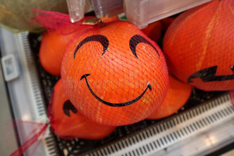 Funny pumpkins with smile in the supermarket stock images