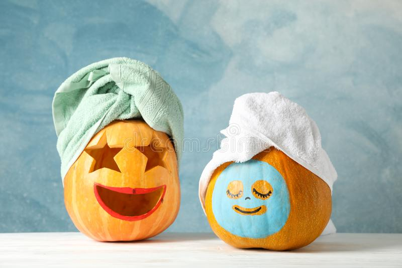 Funny pumpkins with towels on white background royalty free stock photography