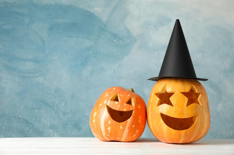 Funny pumpkins on white wooden background royalty free stock photography