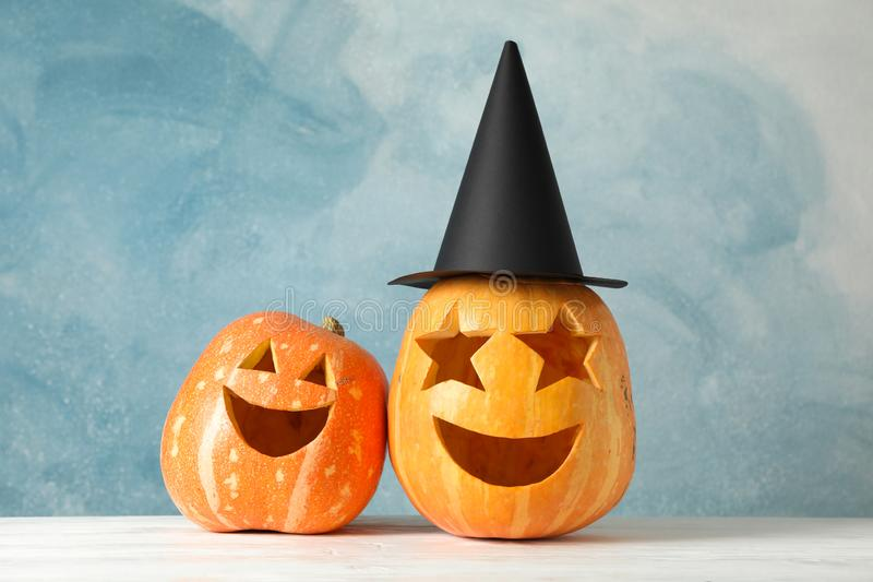 Funny pumpkins on white wooden background royalty free stock photos