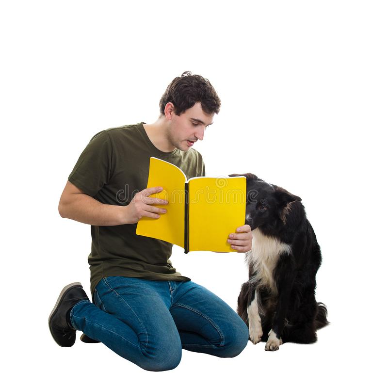 Man and dog reading book royalty free stock photo