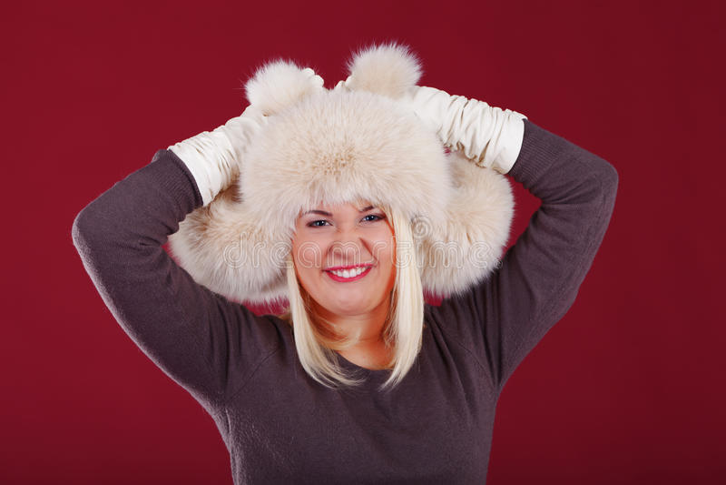 Funny rabbit. Girl showing funny rabbit using hat stock photos
