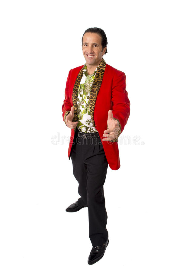 Funny rake playboy and bon vivant mature man wearing red casino jacket and Hawaiian shirt standing happy posing gigolo alike. Funny rake playboy and bon vivant royalty free stock photography
