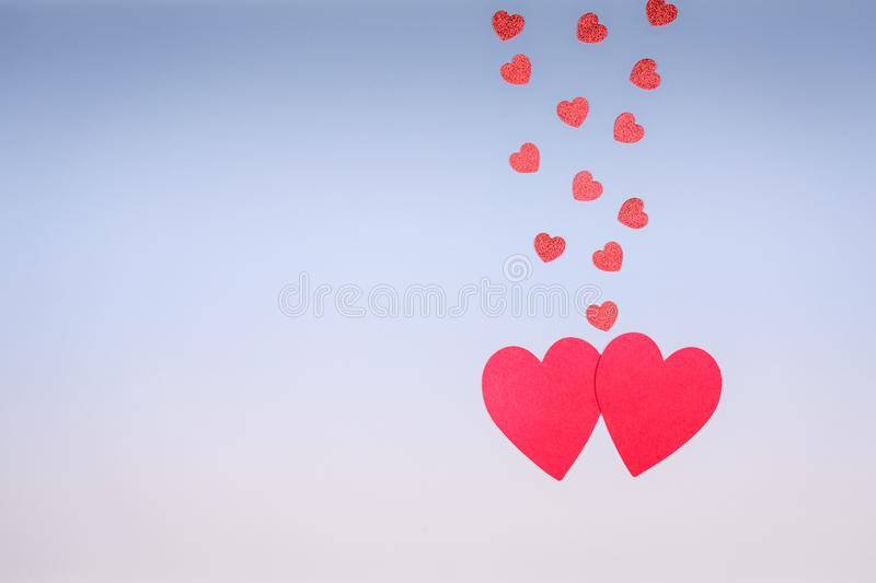 Funny red hearts fall in love. Romance and St Valentine day concept. Two color blue-coral toning royalty free stock image