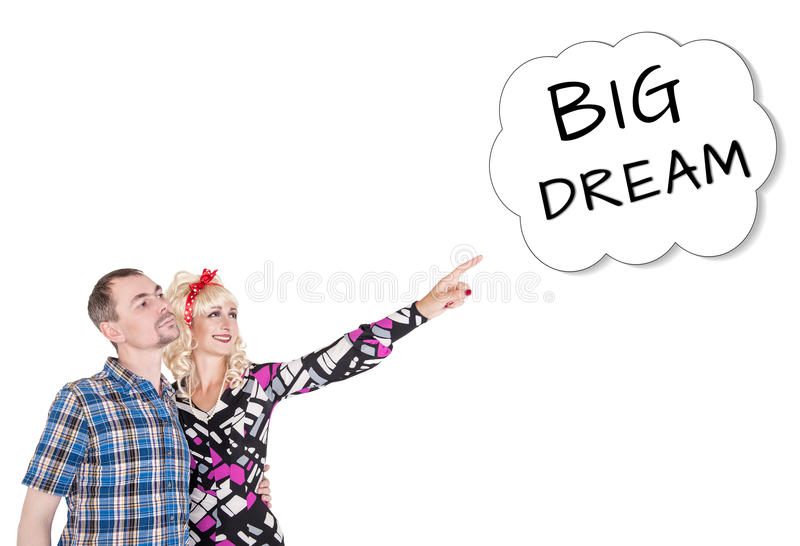 Funny retro family couple embracing and pointing up on dream royalty free stock photography