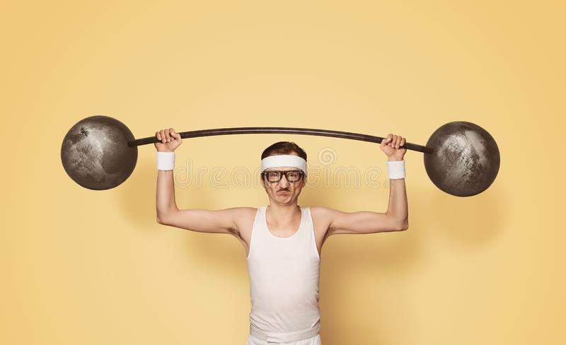 Funny retro sport nerd lifting weights stock images