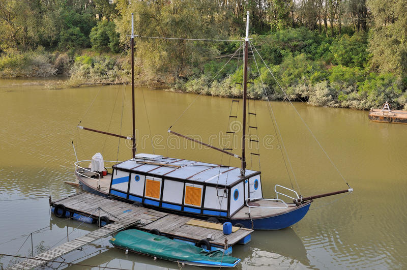 Funny river cruiser, po river. Funny river cruiser docked at quay of harbour on a lateral ramification of po river, in emilia near parma royalty free stock photography