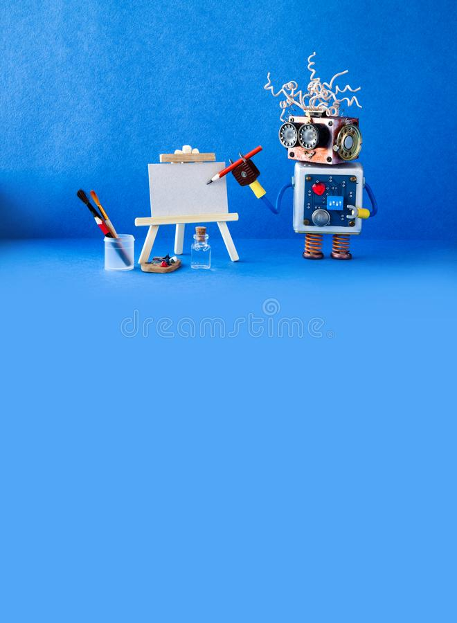 Funny robot artist begins to create a drawing with a pencil. White paper template, wooden easel and artist`s tools. Robot artist begins to create a drawing with royalty free stock photography
