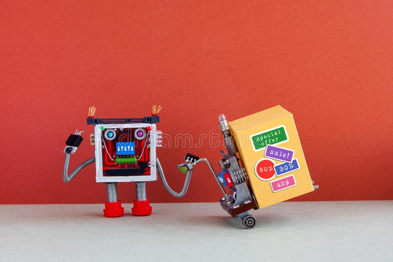Funny robot moving shopping cart big yellow box with discount advertising stickers. Special sale promotion poster. Red. Gray background, copy space stock photo