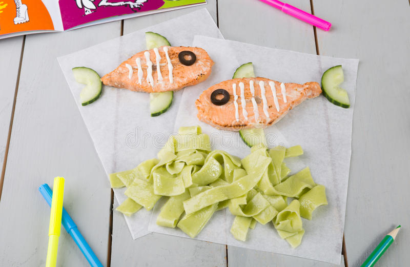 Funny salmon steaks for kids royalty free stock image