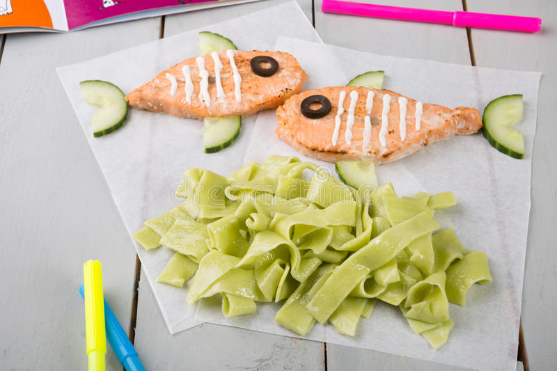 Funny salmon steaks for kids royalty free stock photography