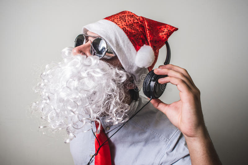 Funny santa claus babbo natale listening music royalty free stock images