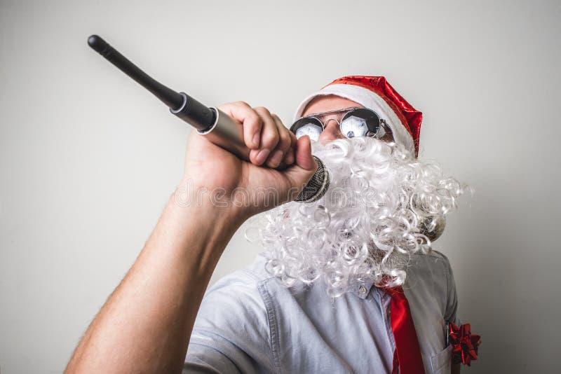 Funny santa claus babbo natale singing stock photo