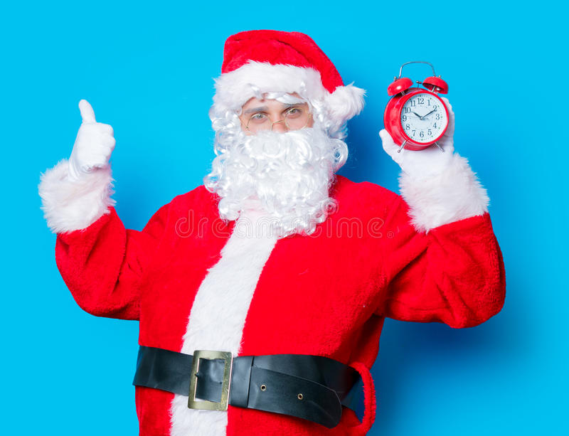 Funny Santa Claus have a fun wtih alarm clock stock images