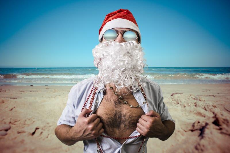 Funny santa claus super hero beach summer christmas stock photos