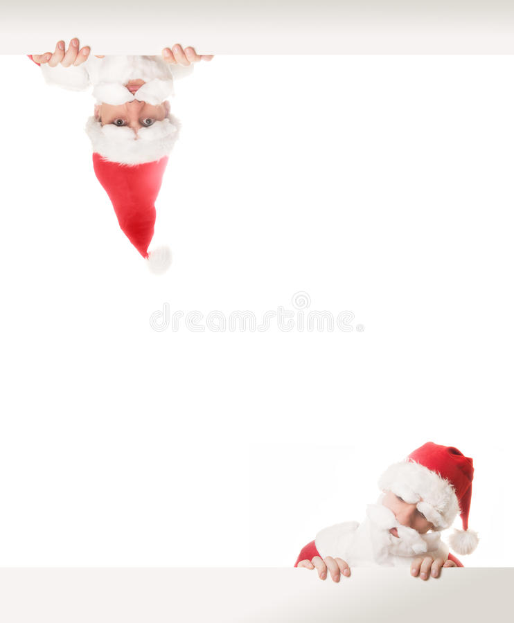 Funny Santa Clauses. Behind the white boards stock photography