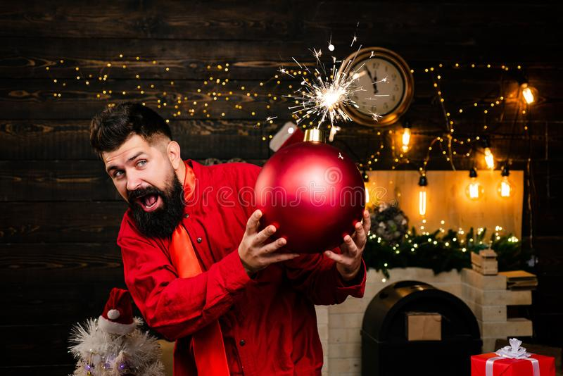 Funny Santa wishes Merry Christmas and Happy new year. Sparkle blast. Hipster Santa claus. Bomb text copy space. Bomb royalty free stock image