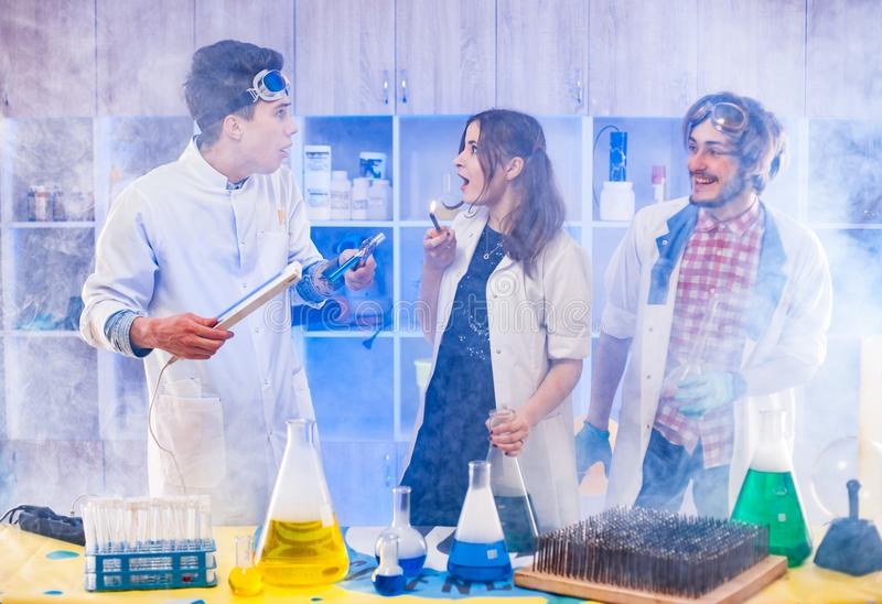 Funny scientists standing in smoke stock images