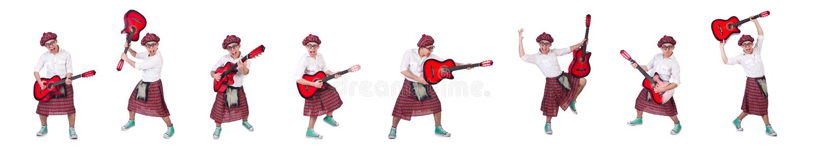 Funny scotsman with guitar on white stock photos
