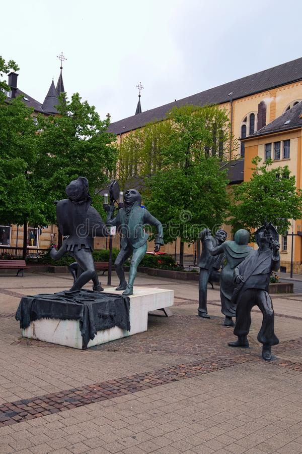 Funny sculptures on the square Place du Theatre near Theatre des Capucins in Luxembourg stock photography