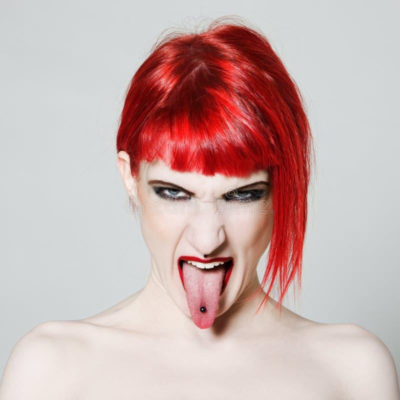 Funny & expressive redhead girl stock photo