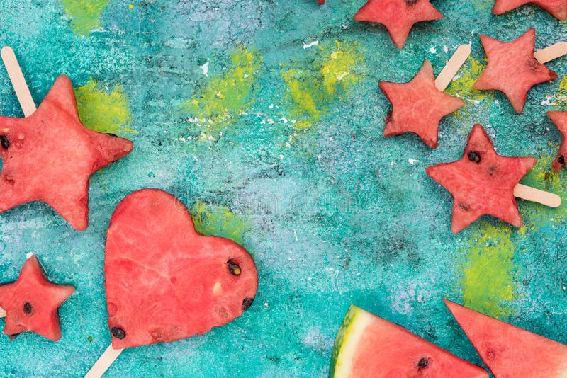 Funny shapes from watermelon popsicels stock photo
