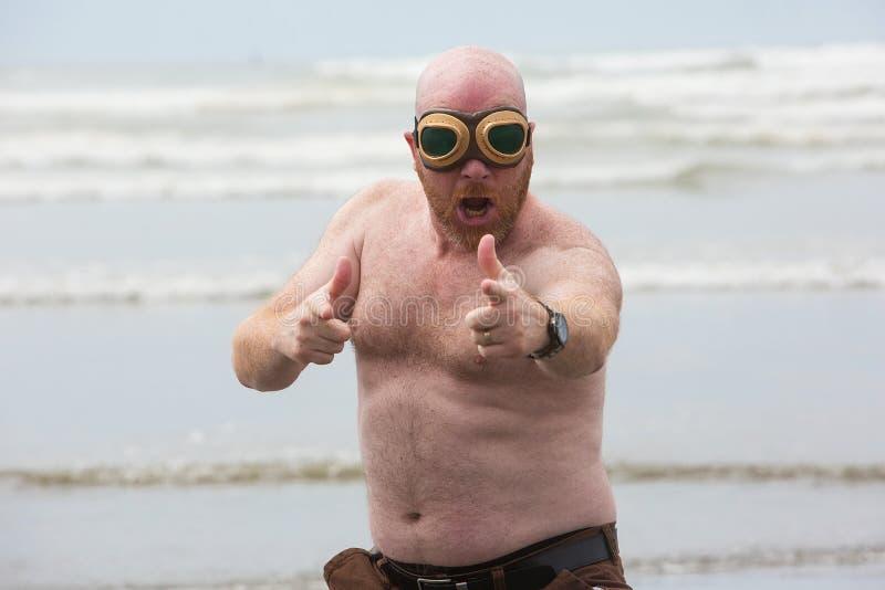 Funny shirtless man at the beach royalty free stock photos