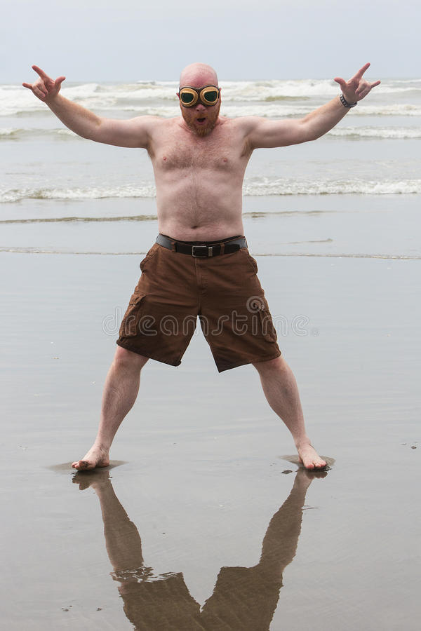 Funny shirtless man at the beach royalty free stock images