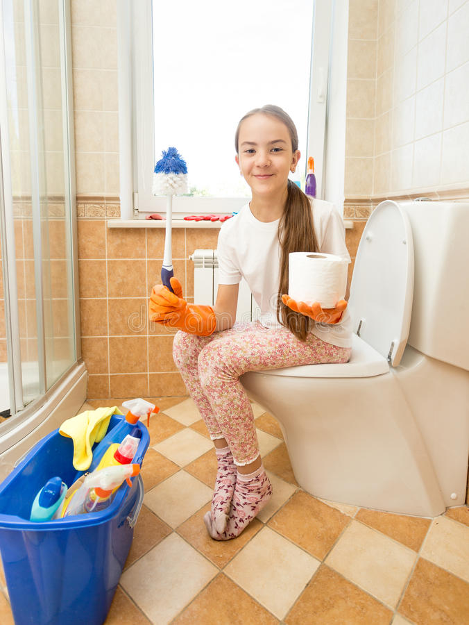 Funny Shot Of Girl Posing On Toilet With Brush And Toilet ...