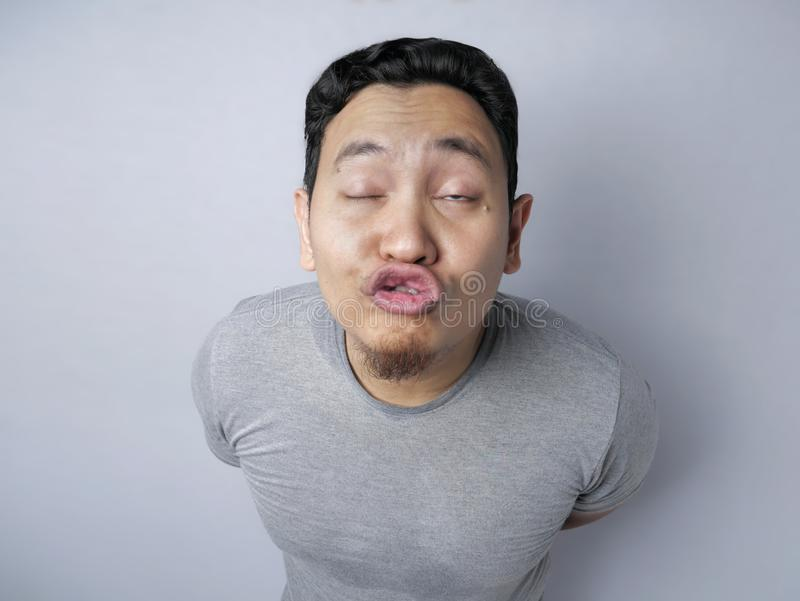 Funny Silly Asian Man Trying to Kiss stock photos