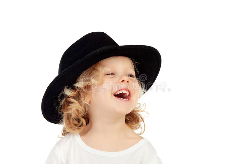 Funny small blond child with black hat stock images
