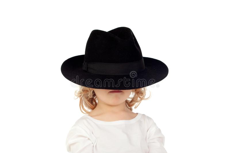 Funny small blond child with black hat stock photos