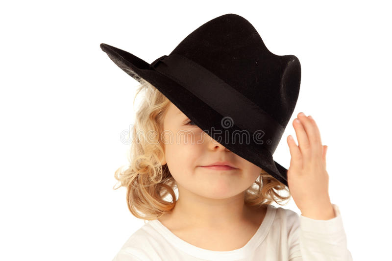 Funny small blond child with black hat royalty free stock images