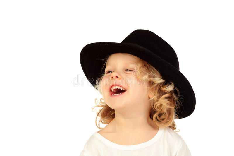 Funny small blond child with black hat royalty free stock photo