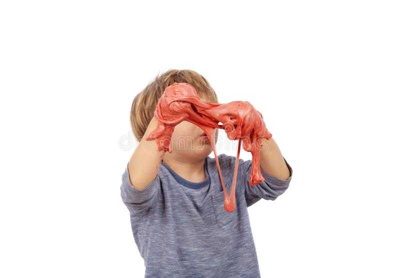 Funny small boy playing with slime. Isolated on white background royalty free stock photos